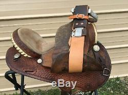 Used US made15 Western barrel saddle withbasket stamped leather good condition